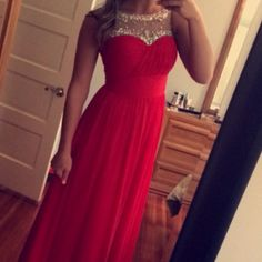 Beautiful red prom or formal dress!! This dress is such a pretty red! It flows so nicely and has beautiful detailing. Size 6, was hemmed to length of a 5'7 girl wearing flats! Perfect for prom or a formal dance or wedding! Color best shown in pictures 2 and 4! Make an offer!! Can go cheaper on merc! Colors Dresses Maxi