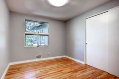 Gray is still the perfect neutral with white trim and wood floors.
