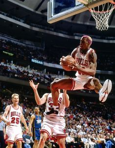 Dennis Rodman, of the Chicago Bulls, snags another of his many rebounds during a game in the NBA. Rodman was always more of an expert rebounder than a scorer. Basketball Pictures, Sports Basketball, Native American Images, Native American Indians, Phil Jackson, Michael Jordan Basketball, Dennis Rodman, Fourth World, Black History Facts