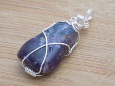 Cacoxenite Amethyst Tumbled Polished Super 7 Stone by OurBackYard