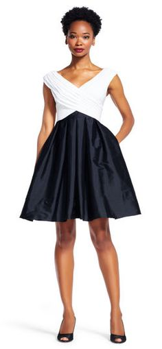 Adrianna Papell draped fit and flare dress | Colorblocking contrasts a majorly feminine design in this gorgeous fit and flare dress. From cocktail parties to formal events, this stunning dress will traverse them all featuring a draped jersey bodices with dramatic collar-baring cap sleeves that sweeps the bodice in a criss cross design. A full taffeta skirt with convenient pockets completes this short party dress. Paired with peep toe pumps, there's no outdoing this beautiful cocktail dress.