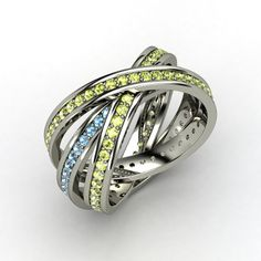 These are called brilliant triple rolling rings in peridot and blue topaz. Such a pretty gem combination from our sponsor Gemvara.