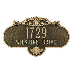 "The Whitehall Products Rochelle Grande Address Plaque adds a classic vintage look to your front door. The rust-free and lightweight cast aluminum is handcrafted to make this address plaque and ensures excellent quality. The weather resistant paint lend style and durability to it. The Rochelle Grande Address Plaque by Whitehall Products is manufactured in the United States. The address plaque holds up to seventeen 1.25"" characters on line two and up to five 3"" characters on line one...."