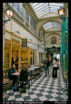 This cafe has a very european look and feel to it. The black and white flooring works well with the bright colors.
