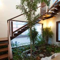 Pasillo, hall y escaleras de estilo  por Muraliarchitects