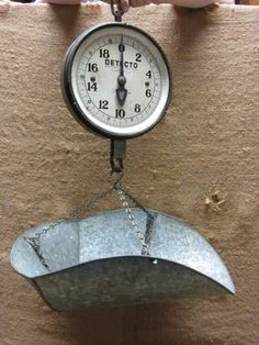 looove old hanging scales!!! perrrfect for country cottage!!! this one has a great size and shape bucket....could hold dried flowers