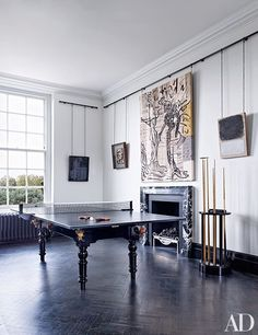 Overlooking the Ping-Pong table in the game area are works by, from left, Rosemarie Trockel, Frank Auerbach, Peter Linde Busk, and Mark Rothko | archdigest.com