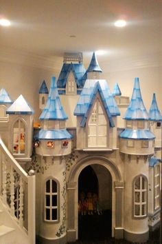 This big indoor playhouse, the Wizard of Oz Castle, is meant for spaces with lots of kids playing at once. Includes slide, staircase, and hand painting. Kids Indoor Playhouse, Build A Playhouse, Backyard Playhouse, Princess Bedrooms, Princess Room, Girl Room, Girls Bedroom, Castle Playhouse, Family Room Design