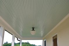 Paint ceiling on front & back porches with Haint Blue Sherwin-Williams Haint Blue Porch Ceiling, Colored Ceiling, Ceiling Color, Blue Ceilings, Blue Paint Colors, Porch Lighting, Lighting Ideas, Outdoor Ceiling Fans, Exterior Paint