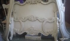 boring modern cream coloured bed transformed in to an antique style using General Finishes Milk Paint and Glaze.