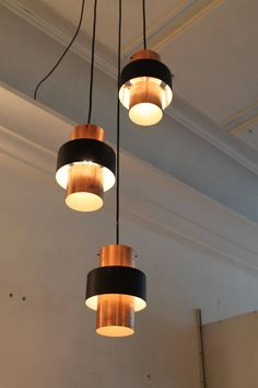 Three Saturn Pendant by Jo Hammerborg for Fog and Morup 1960s Denmark | From a unique collection of antique and modern chandeliers and pendants  at https://www.1stdibs.com/furniture/lighting/chandeliers-pendant-lights/