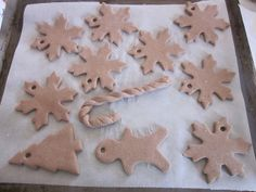 """salt dough ornaments with a touch of cinnamon: 1c salt, 2 c flour, 10t cinnamon, roughly 3/4c water. Mix until forms a ball. put in refrig for 30 min to stiffen, roll it out to 1/2"""" thick, cut out, make a hole with a straw (or other item), bake until dry at 325 f - about an hour on parchment paper."""