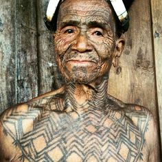 Tattooed Konyak Man from the headhunter tribes of Nagaland, North East India