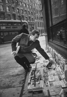 British TV presenter David Frost, stopping for a newspaper at a newsstand in London - 1968