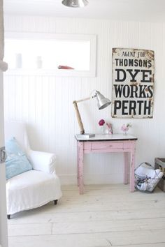 Shabby pink table.  Love the pink girlyness with the industrial accents.