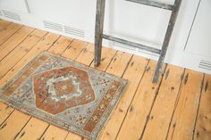 Super charming little rug mat with awesome shades of rust and slate grey