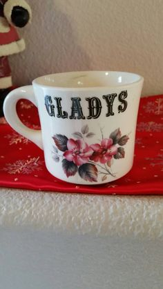 Check out this item in my Etsy shop https://www.etsy.com/listing/261490985/gladys-personalized-floral-mug
