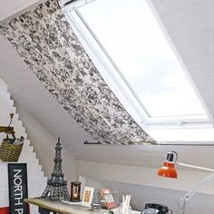 Now my loft would look a whole heap better painted white and a little curtain on the velux.: