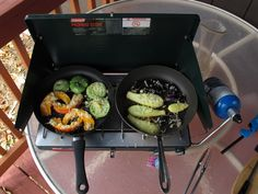 Camp stove on porch with fresh vegetables from the garden.