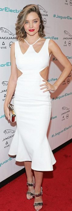 Who made  Miranda Kerr's jewelry, silver clutch handbag, white cut out dress, and silver spike sandals?