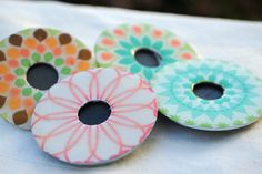 Tablecloth weights made from a decoupaged washer and a magnet on the back