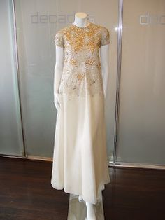 Christian Dior Haute Couture by Marc Bohan P/E ecru embroidered short sleeve gown.