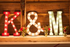 The couple's wedding colors were reflected in their illuminated initials at the reception.