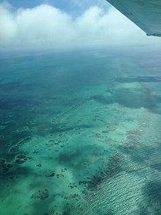 Flying over Belize coast line and islands