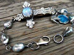 Cross Bracelet with rose-cut moonstone, grey freshwater pearls and vintage charms...by Elizabeth Payne for www.jewelryartsstudio.com