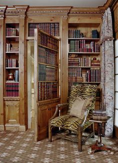 Hmm, I think the books (disguising the door) are fake, and its an idea which has been used quite a lot but I still want one!