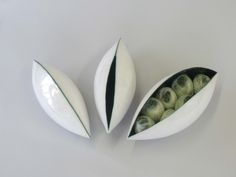 Lucie Berben, ceramic pods with felted seeds. http://www.lucieberben.nl/HTML/zaden.html