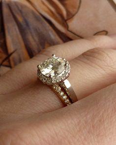 Round Moissanite and Diamond Halo Ring - 14k White Gold. $2,295.00, via Etsy.