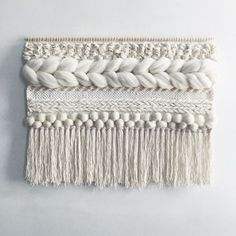 This is a made-to-order hand woven wall hanging made from natural un-dyed roving and cotton fringe in a palette of creamy neutrals. The dowel is 36 inches wide, and the whole weaving measures 36x28 inches, including the fringe. It makes a beautiful statement piece for a bedroom or living room, or as a special wedding gift. This weaving is made to order (~2 weeks), and comes with the dowel, ready to hang. Made by hand on a frame loom. Please contact me with any questions.