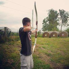 He learns eerily fast... #archery #boyfriend #recurve #barebow #targetpractice #summer #Padgram