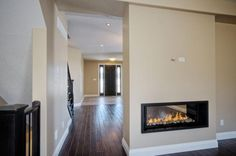 Two Sided Fireplace Designs   Mapleridge Two Sided Gas Fireplace   Hawksview Homes