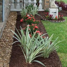 placing rocks between the wall and the flower beds keep the plants away from the wall and help keep foundation dry