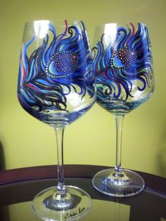 Peacock Feather painted wine glasses. So cute!