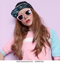 Amazing sexy brunette girl skateboard style cap, beauty swag style, Tomboy fashion in trendy pink glasses Vanilla style