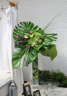 Image result for flower arranging large leaves