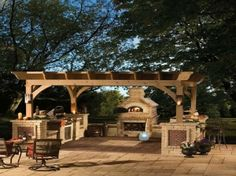 Covered Patios And Outdoor Kitchens | Amazing covered deck patio with brick outdoor fireplace, flatscreen tv ...
