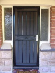wrought iron security door - Would like more scroll work but otherwise good idea Wrought Iron Security Doors, Steel Security Doors, Wrought Iron Doors, Window Grill Design Modern, Grill Door Design, Door Gate Design, Metal Screen Doors, Steel Gate Design, Safe Room
