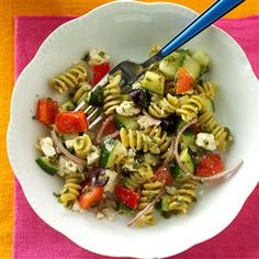 Spring Greek Pasta Salad Recipe -For a light meal, we toss rotini pasta with cucumber, zucchini and sweet peppers. Make it into a main dish by adding grilled chicken. —Christine Schenher, Exeter, California