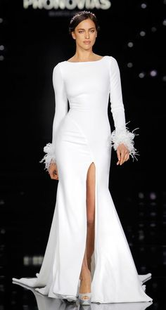 Supermodel Irina Shayk opened the fashion show wearing the Pronovias Nuria gown made of crepe, embroidery and feathers. Shop Now: Pronovias Wedding Dress Spring 2017 Wedding Dresses, Wedding Dress Trends, Wedding Attire, Bridal Dresses, Irina Shayk, Bridal Collection, Dress Collection, Spring Collection, Glamour