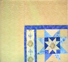 Blue star blocks float across a butter yellow background. The corner double-star blocks have Eleanor Burns rose bouquet centers. Rose bouquets are repeated in the second border.  The backing is a bright mottled yellow. This quilt has been quilted with edge to edge Lacy Swirls.  We had lighting problems with the pictures and will try to update them, but the background fabric color is pretty close to the middle of the full picture - think butter yellow - the bluish tint is not accurate and the…