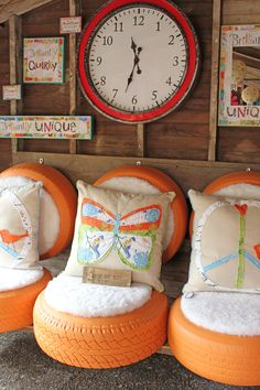 Turn tires into cute love seats for your porch by spray painting them a bright color and then adding soft, cushioned seats and printed pillows.  Learn more at Itsy Bits And Pieces.   - CountryLiving.com