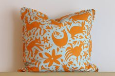 Orange Animals on Blue pillow by KariFisherDesign on Etsy: More pillows! Orange and blue animals work with the modern, woodland motif in just the right colors.  #StyleSquared