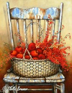 Stella Bruwer wicker basket with pomegranates and flowers on shabby blue chair
