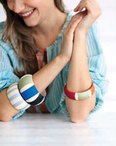 Striped Bangle Bracelets - Make chunky, cheerful bangles with white acrylic paint and tissue paper.