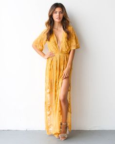 Our gorgeous Thora Maxi Romper is a show stopper. A stunning lace detailed maxi dress overlays a concealed and lined romper. We are obsessed with this stunning one piece, master piece. A perfect state