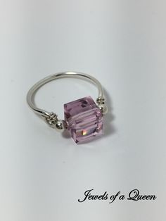 Light Amethyst Ring ~ Swarovski Crystal Ring ~ Wire Wrapped Ring ~ Wire Wrap Jewelry ~ Swarovski Solitaire Ring ~ Amethyst Crystal Ring by JewelsOfAQueen on Etsy https://www.etsy.com/listing/494574764/light-amethyst-ring-swarovski-crystal
